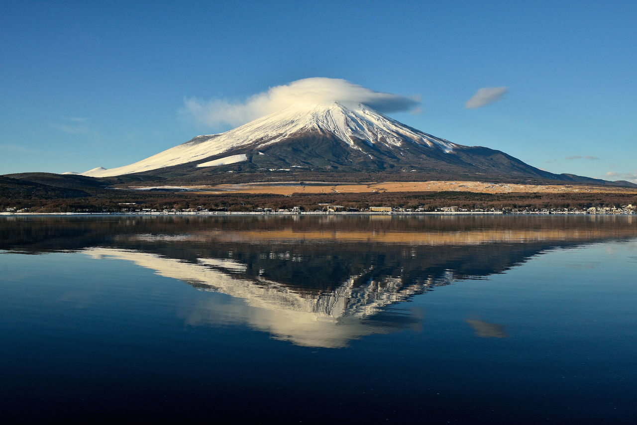 Reflection Of Mt Fuji In Lake Against Sky