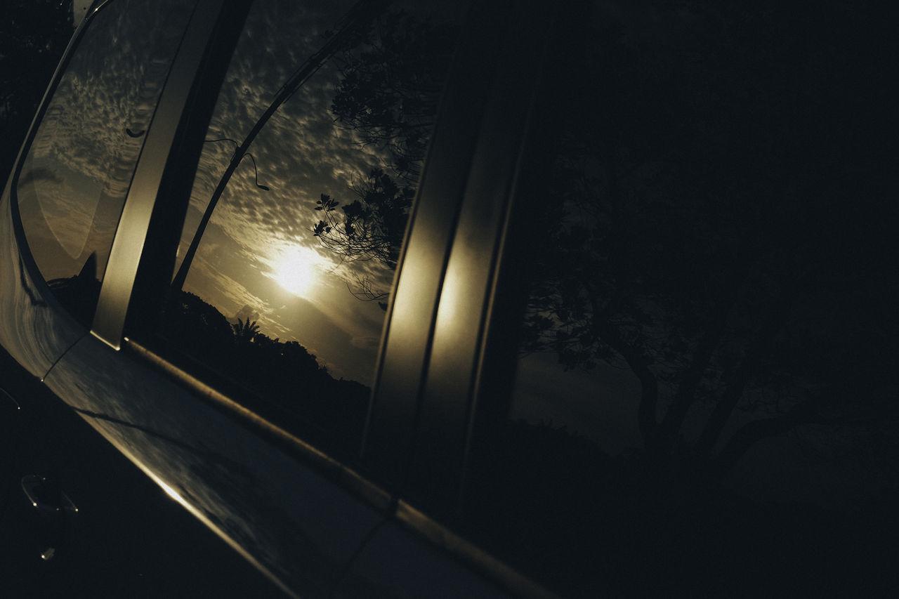 Sunrise reflection on car windows Automobile BYOPaper! Growth Illuminated Indoors  Nature Night No People Reflection Silhouette Silhouette Sky Sunrise Sunset Tree Tree