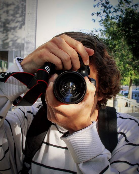EyeEmNewHere Photography Themes Camera - Photographic Equipment Photographing Digital Camera Photographer Technology Leisure Activity Holding Real People Outdoors Men Day SLR Camera One Person Building Exterior Digital Single-lens Reflex Camera Architecture Young Adult Close-up Adult Reflection Focus DSLR Portrait EyeEmNewHere