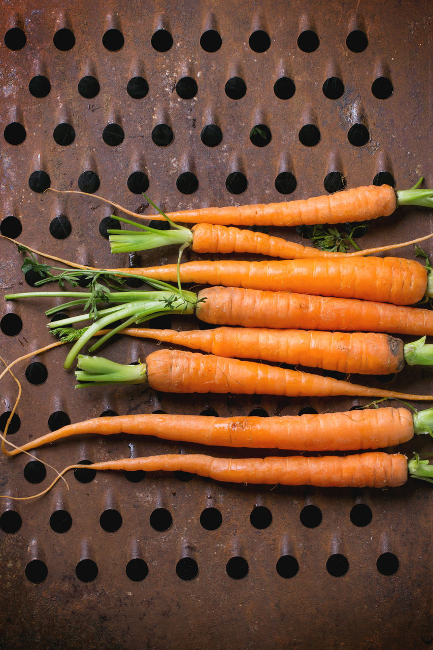 High Angle View Of Carrots On Rusty Metallic Grater