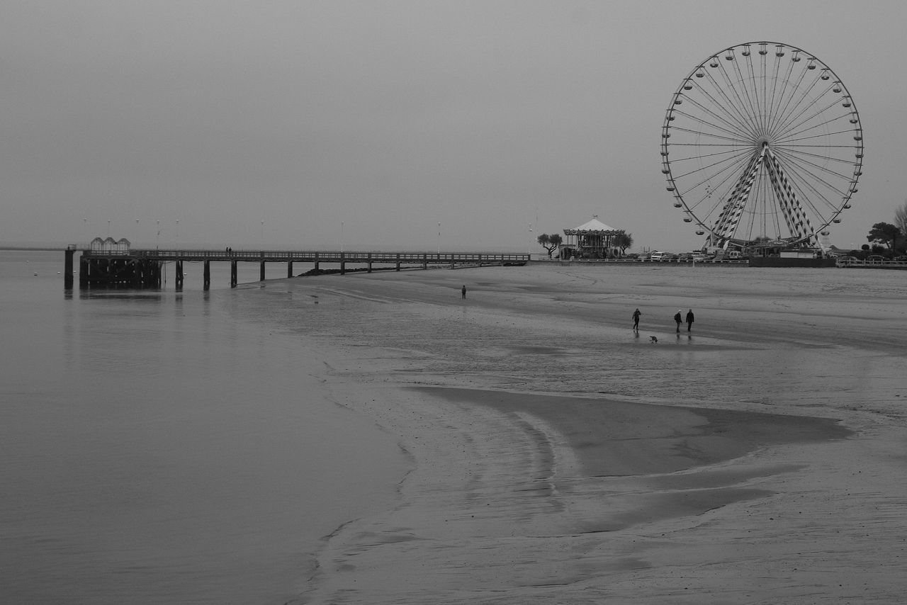 beach, sand, ferris wheel, amusement park, sea, water, outdoors, leisure activity, nature, day, sky, vacations, clear sky, no people