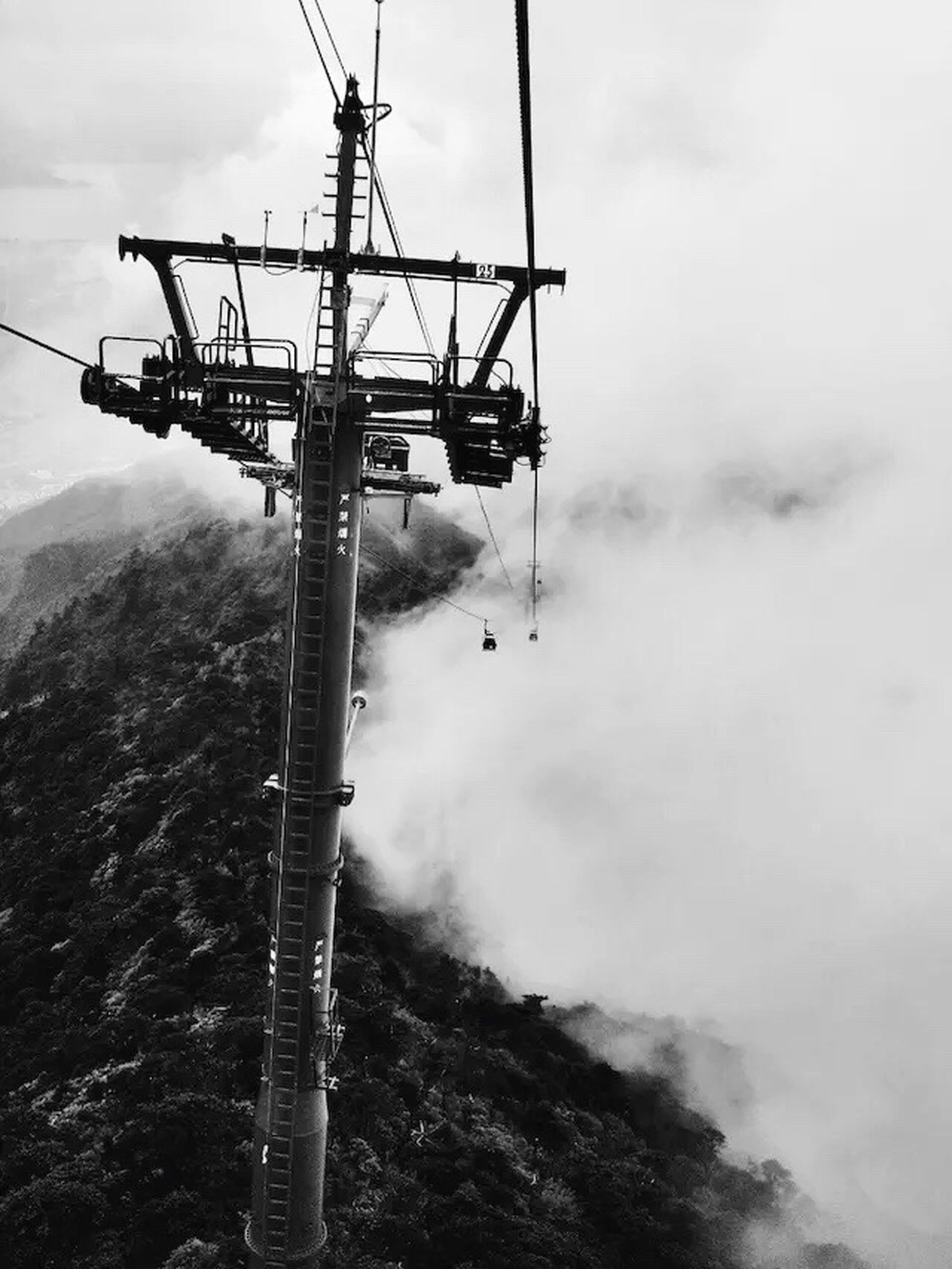 sky, cloud - sky, cloudy, weather, fuel and power generation, electricity, electricity pylon, transportation, connection, low angle view, power line, nature, overhead cable car, mountain, technology, tranquility, day, tranquil scene, mode of transport, overcast