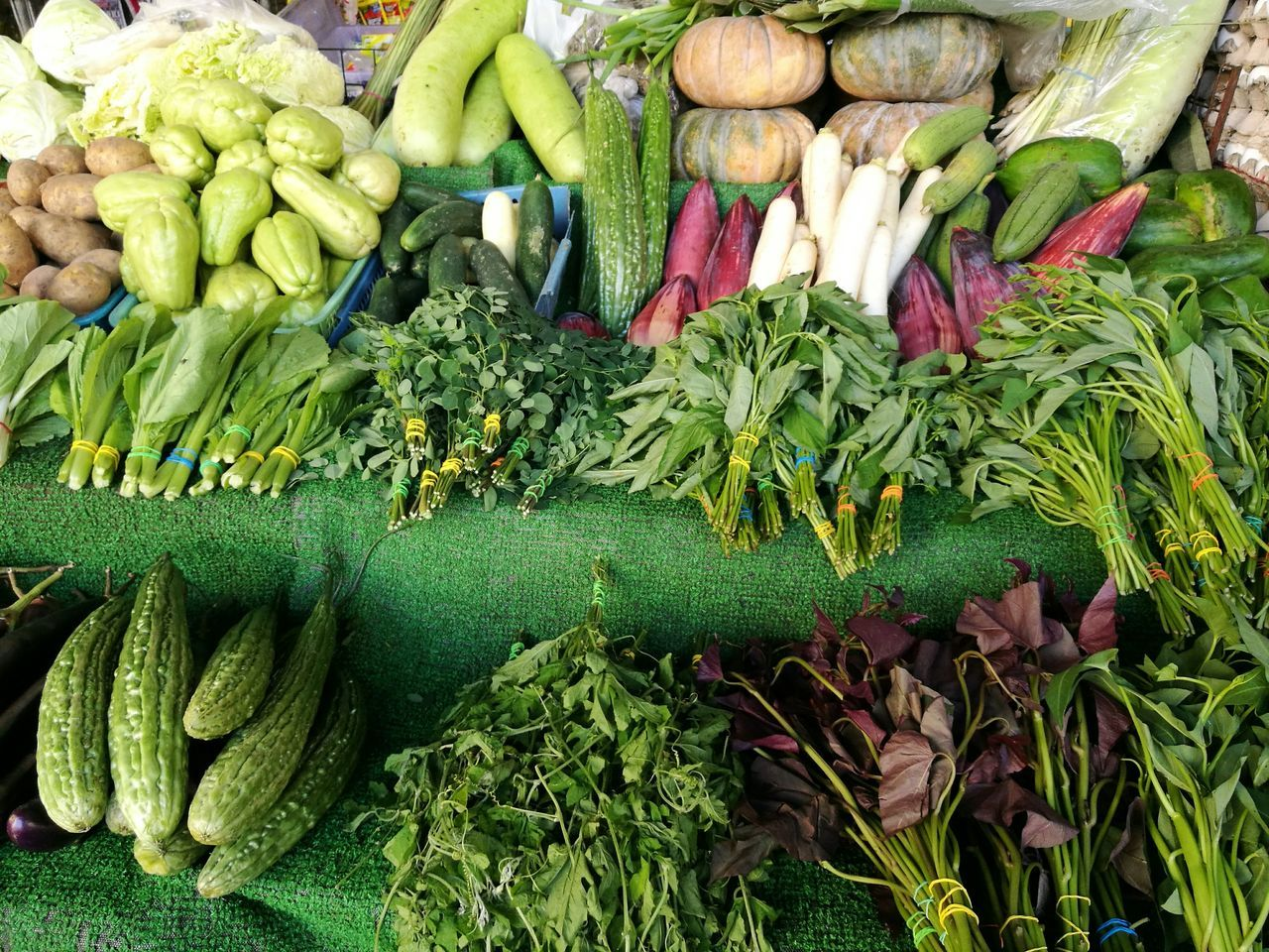 vegetable, food and drink, variation, freshness, large group of objects, healthy eating, green color, abundance, food, market, for sale, choice, retail, raw food, market stall, no people, cucumber, day, groceries, outdoors, gourd, close-up