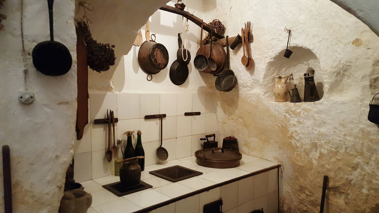 Ancient home in Matera Italy Matera Stone Rocks UNESCO World Heritage Site Ancient Home Kitchen Typical Valley Places Interior Indoors  Home Interior Hanging No People Home Showcase Interior Neat Domestic Room Day