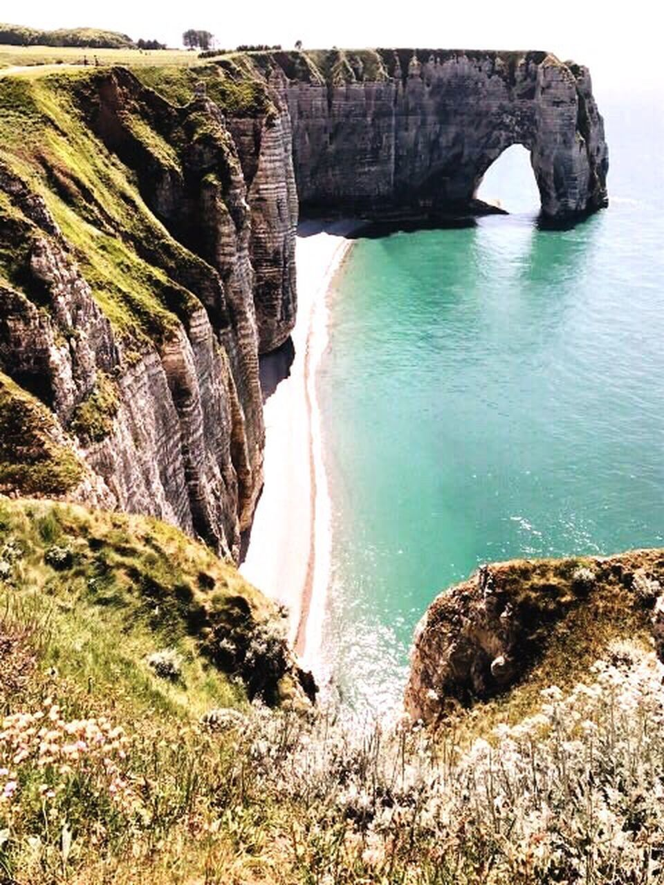 rock - object, rock formation, water, nature, beauty in nature, physical geography, cliff, sea, scenics, day, no people, outdoors