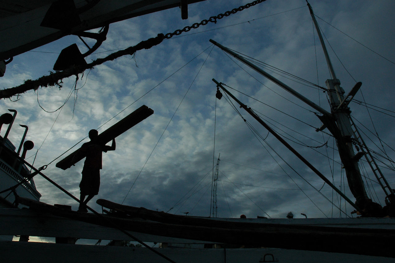 loading and unloading activities at the port, Sunda Kelapa Jakarta. Adult Adults Only Backgrounds Cloud - Sky Day Documentary Life Low Angle View Migrant Workers One Man Only One Person Only Men Outdoors People Port Portrait Postcard Silhouette Sky Wallpaper Worker Print