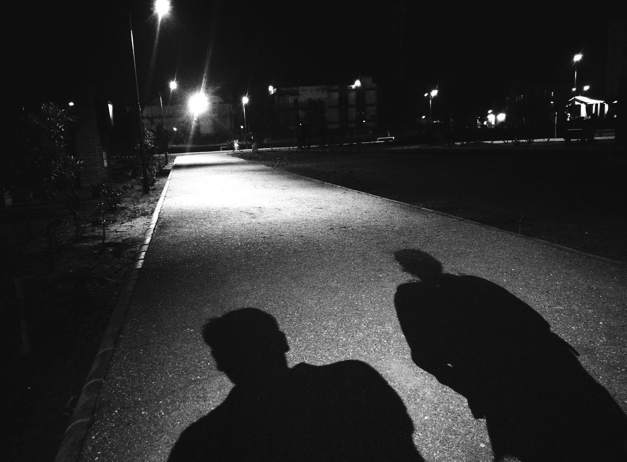 night, illuminated, silhouette, real people, shadow, outdoors, togetherness, two people, childhood, city