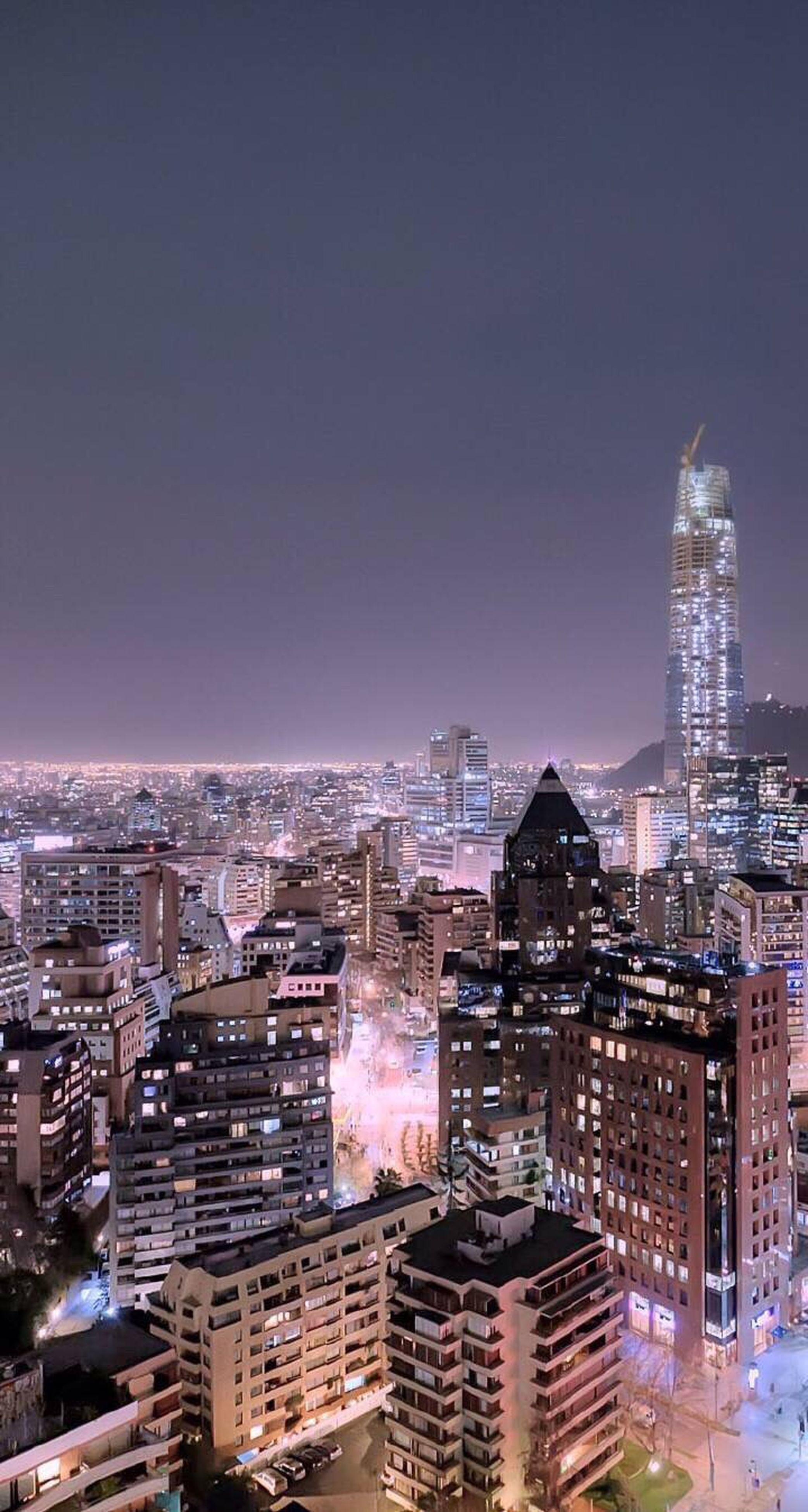 cityscape, city, building exterior, architecture, built structure, crowded, skyscraper, clear sky, tower, modern, illuminated, tall - high, high angle view, copy space, office building, residential district, capital cities, night, aerial view, city life