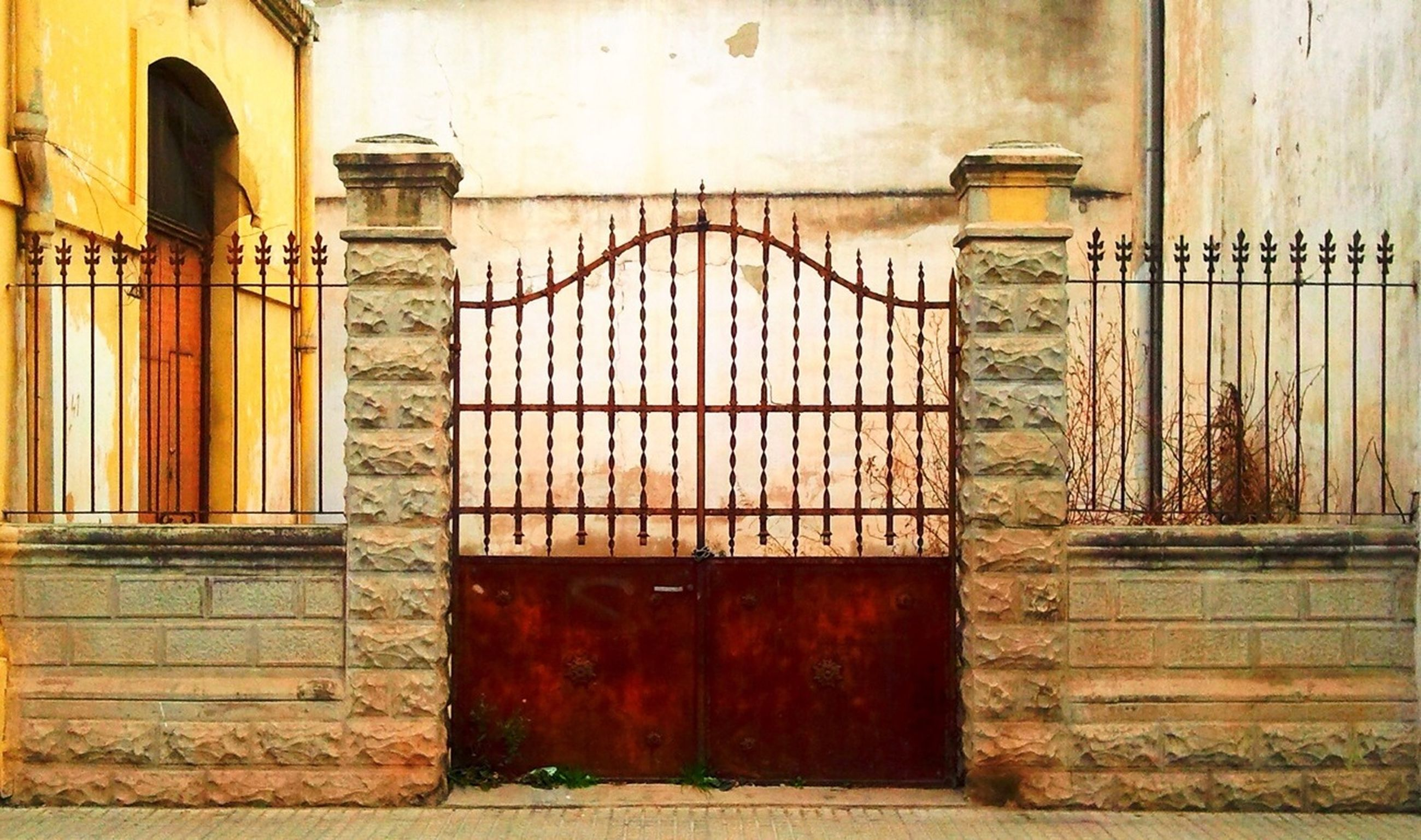 closed, architecture, built structure, door, safety, protection, building exterior, security, metal, entrance, window, house, wall - building feature, gate, wood - material, old, no people, outdoors, day, building