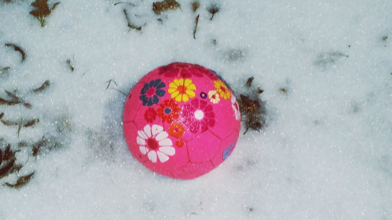 High Angle View Directly Above Snow Winter Leaves Ground Soccer Ball Pink Flowery Ice Items Sports Kids Toys Looking Down Play Single Object