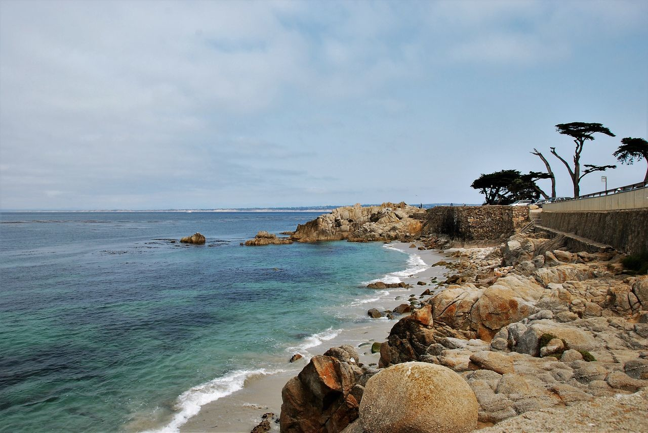 View of Lover's Point in Pacific Grove, CA Beach Beauty In Nature California Cloud - Sky Coastal Feature Coastline Idyllic Majestic Monterey Bay Myhappyplace Myperspective MyPhotography Nature Rock - Object Rock Formation Scenics Sea Seascape Shore Sky Tourism Tranquil Scene Tranquility Travel Destinations Water