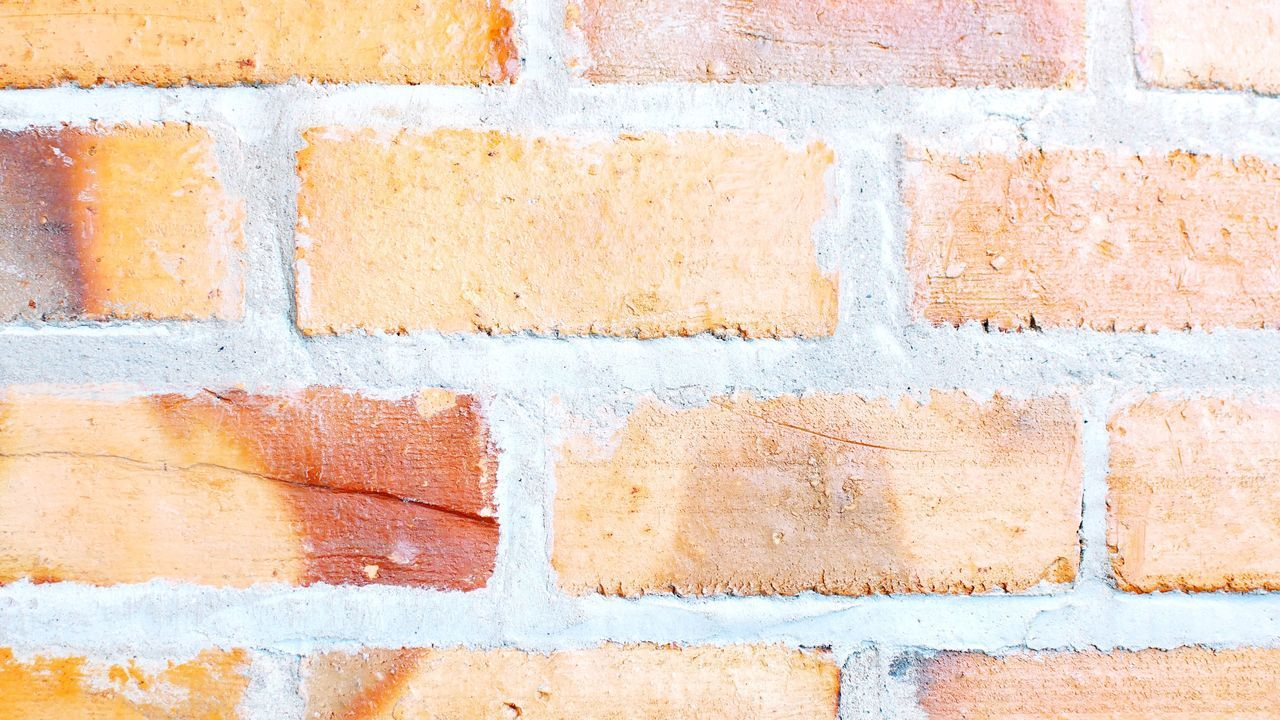 Brick Wall Wall - Building Feature Backgrounds Weathered Full Frame Architecture Paint Built Structure Rough Textured  Yellow Building Exterior No People Outdoors Close-up Day