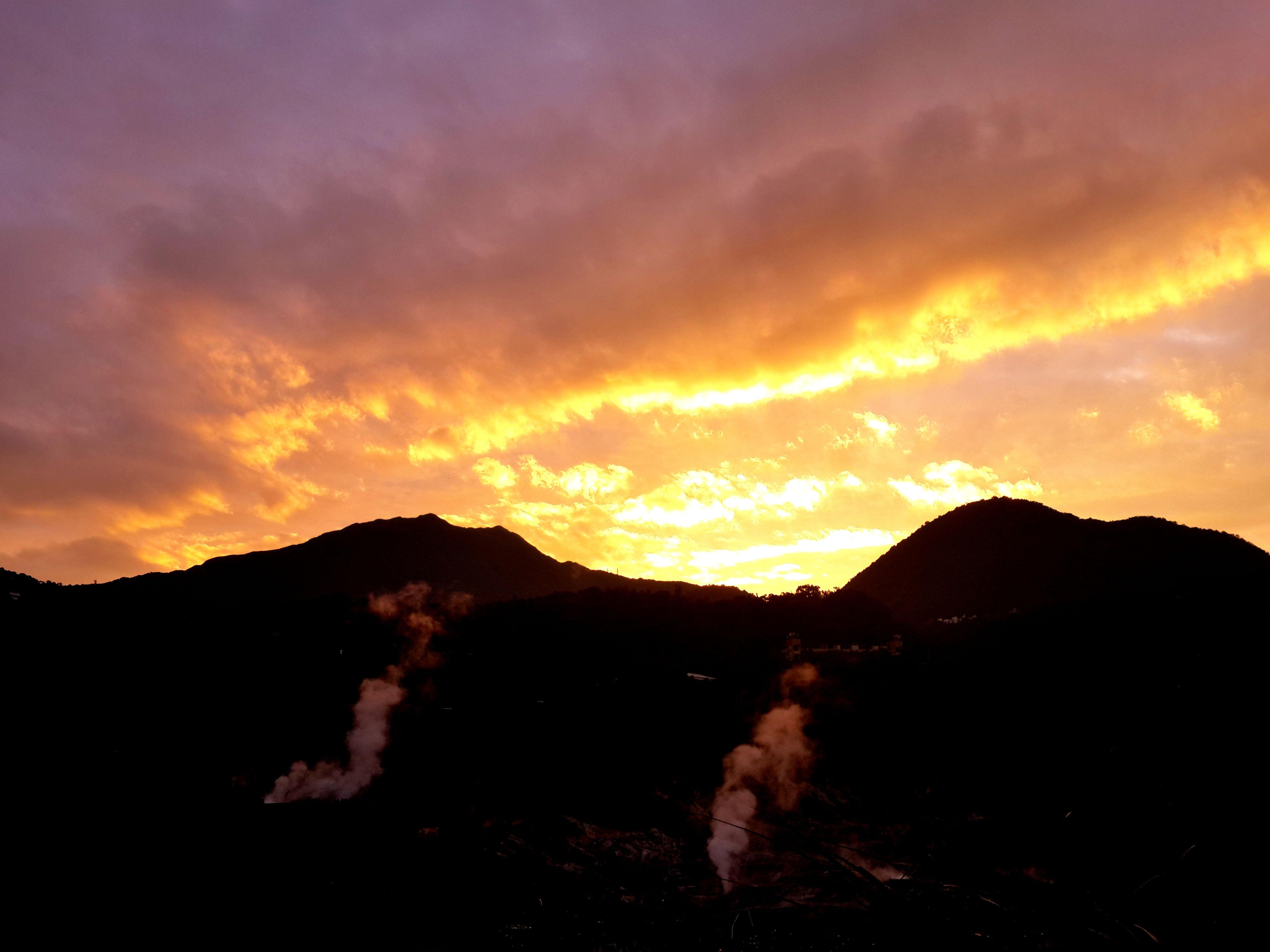 sunset, mountain, scenics, sky, mountain range, tranquil scene, beauty in nature, tranquility, orange color, cloud - sky, idyllic, nature, dramatic sky, cloud, majestic, landscape, outdoors, non-urban scene, dark, cloudy, no people, remote, non urban scene, weather