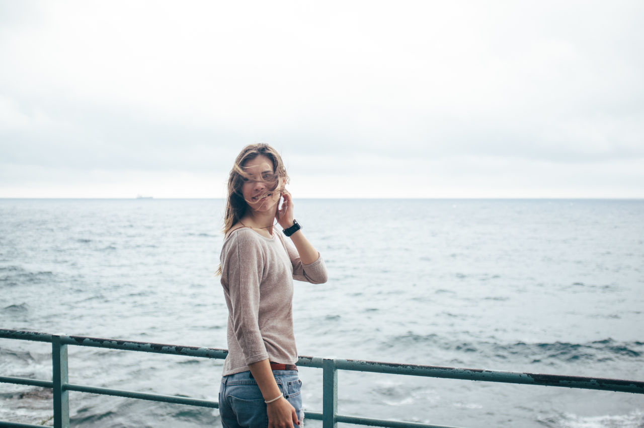 Beautiful stock photos of smile, Arms Raised, Brown Hair, Day, Horizon Over Water