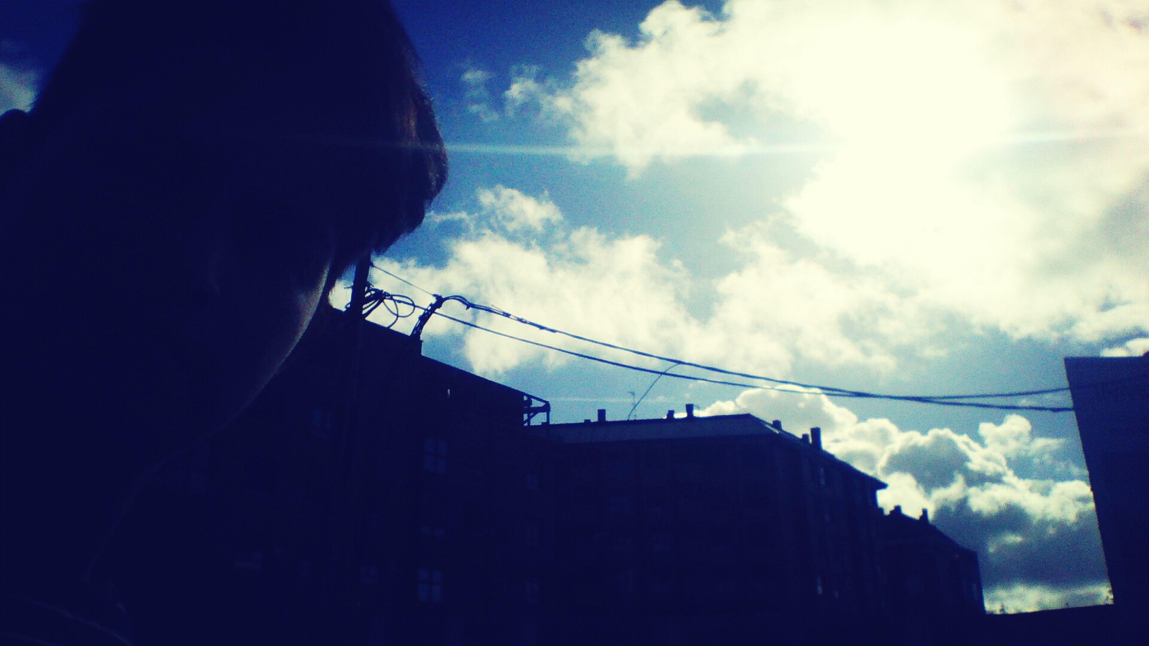 low angle view, silhouette, sky, built structure, architecture, building exterior, cloud - sky, cloud, power line, building, cable, connection, dusk, outdoors, technology, cloudy, blue, electricity pylon, sunlight, city