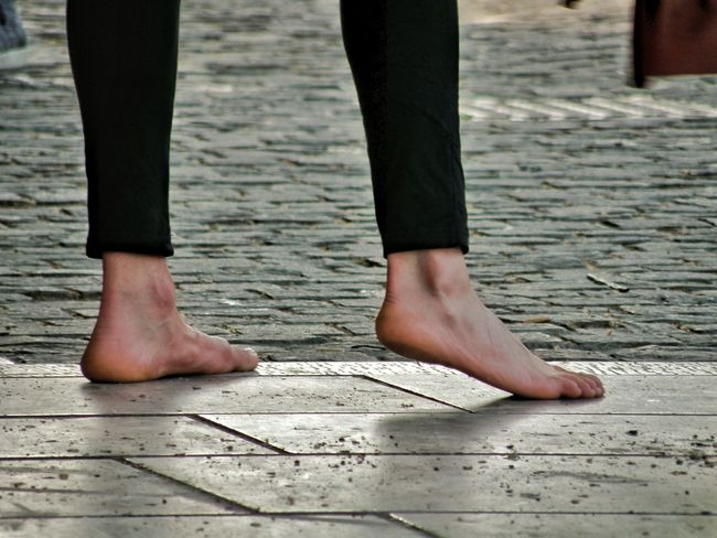 Street Photography Streetphotography Street Artist Street Performer Acrobatics  Beautiful Girl Barefoot Tiled Flooring Feet On The Ground
