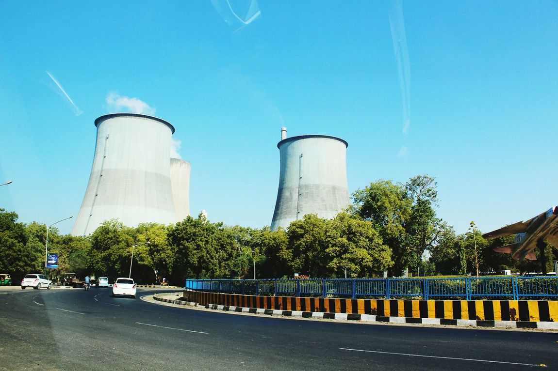 How Do We Build The World? Nuclear Power Plant Gandhinagar Gujarat India This Is My Country 2016 Powerplant That's How It Is Huge . Quite Street yet Noisy. What Is That  Behind The Trees ?