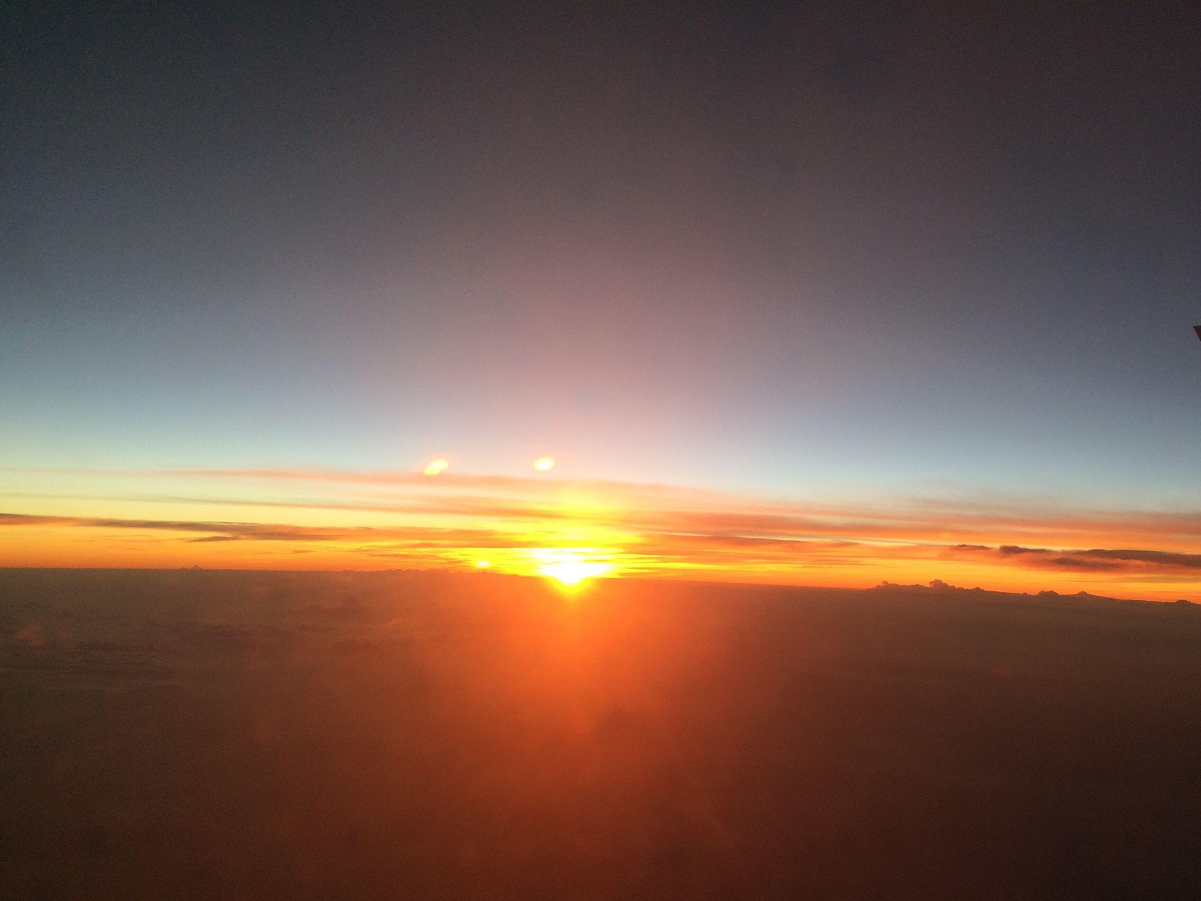 sunset, scenics, tranquil scene, sun, tranquility, beauty in nature, orange color, sky, idyllic, nature, silhouette, landscape, sunlight, copy space, cloud - sky, cloud, outdoors, horizon over land, majestic, no people