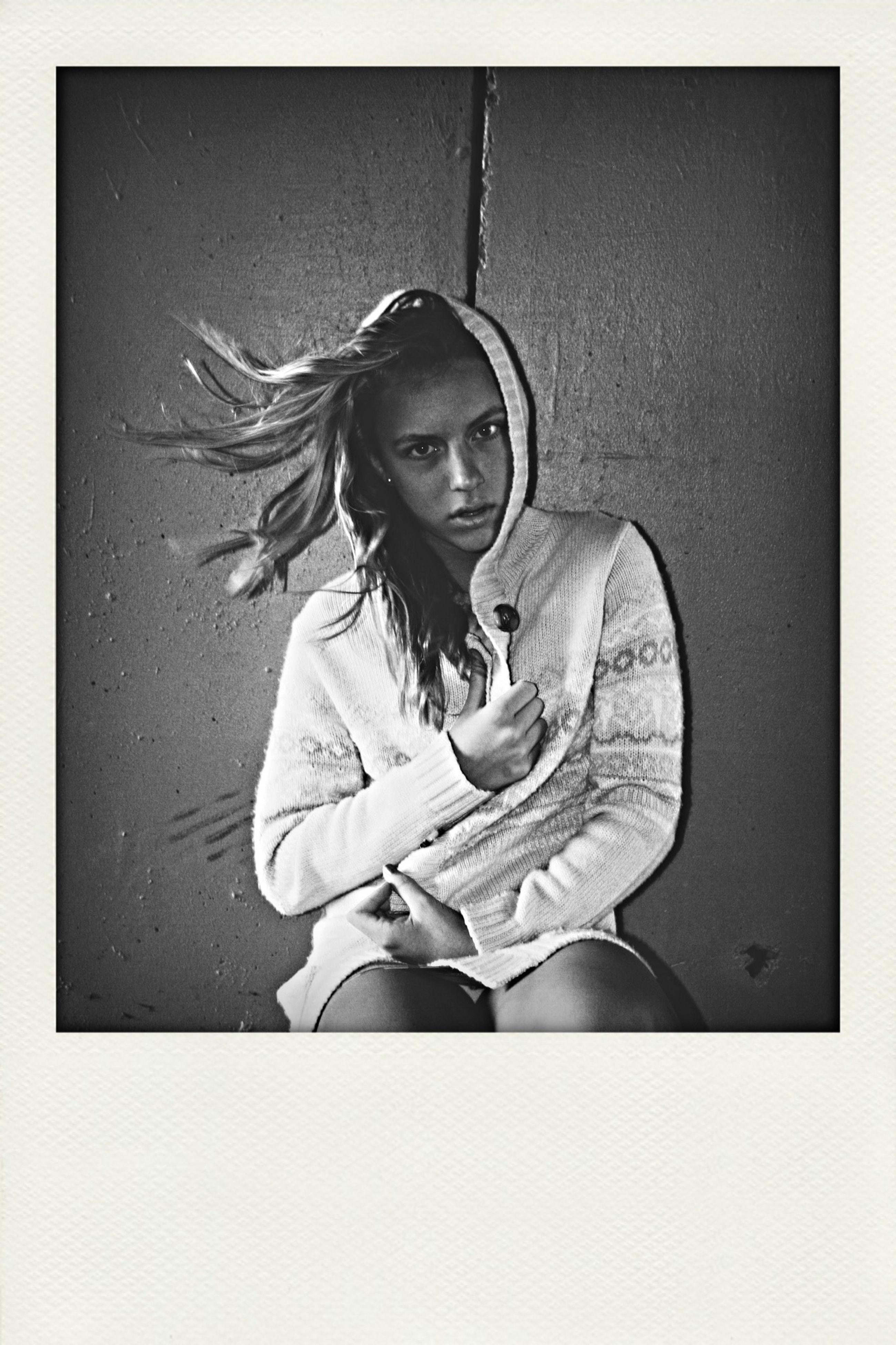 transfer print, auto post production filter, holding, human representation, art, art and craft, lifestyles, front view, indoors, creativity, studio shot, wall - building feature, young adult, leisure activity, casual clothing, standing