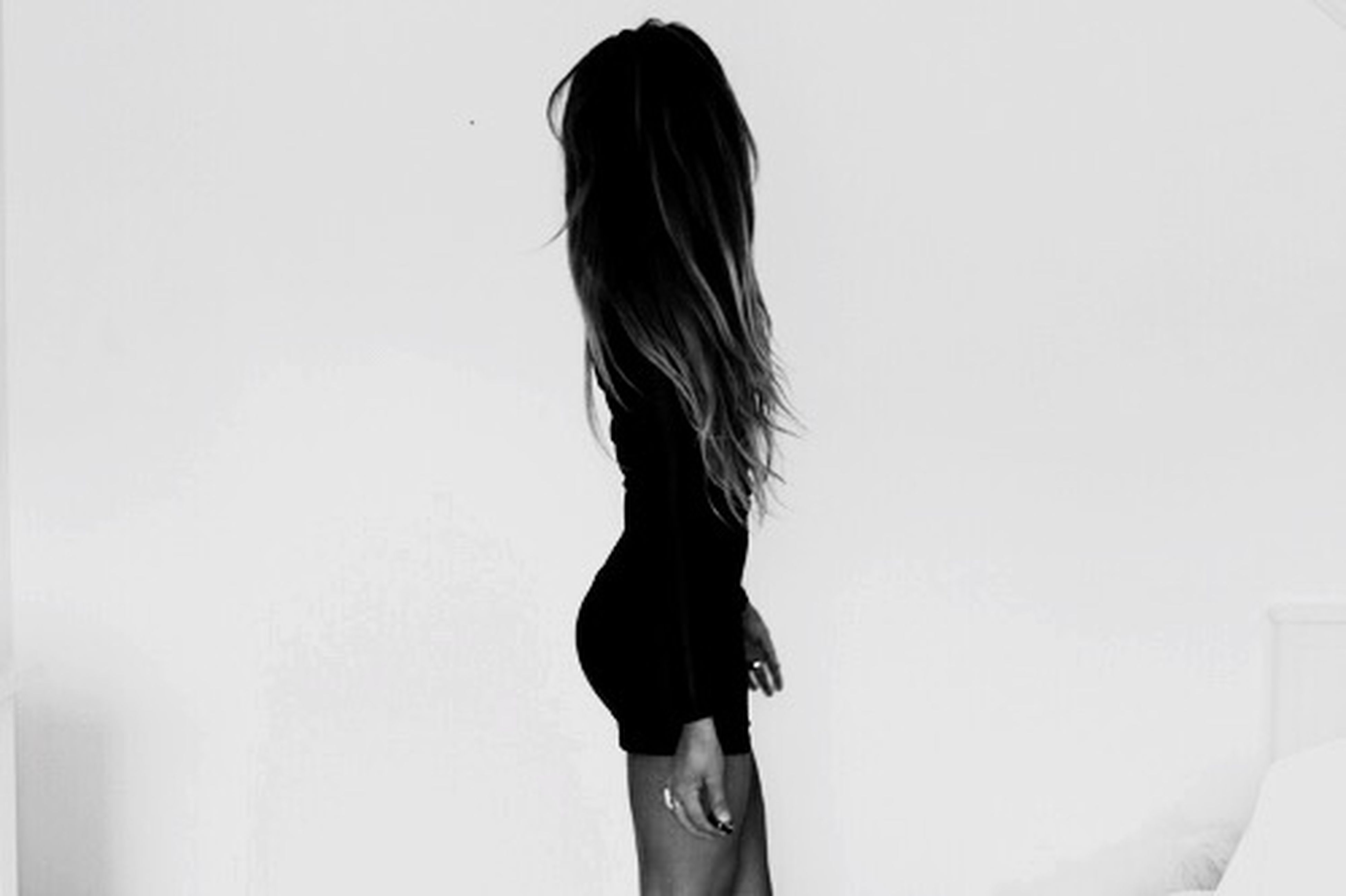 long hair, standing, lifestyles, young women, white background, studio shot, young adult, copy space, person, waist up, rear view, three quarter length, leisure activity, casual clothing, obscured face, femininity, wall - building feature