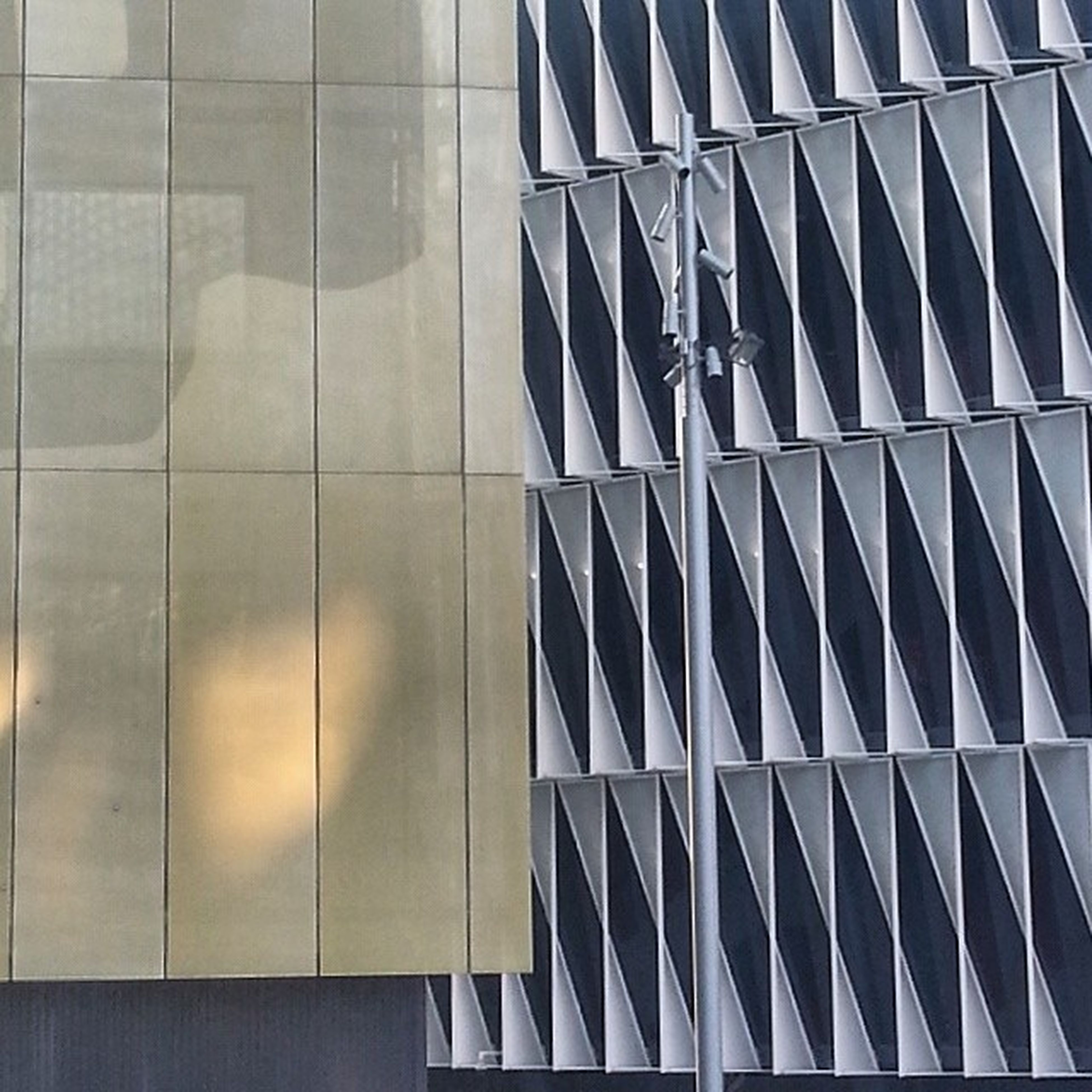 architecture, modern, built structure, building exterior, glass - material, office building, reflection, skyscraper, low angle view, city, tall - high, pattern, tower, building, window, architectural feature, geometric shape, glass, sky, day