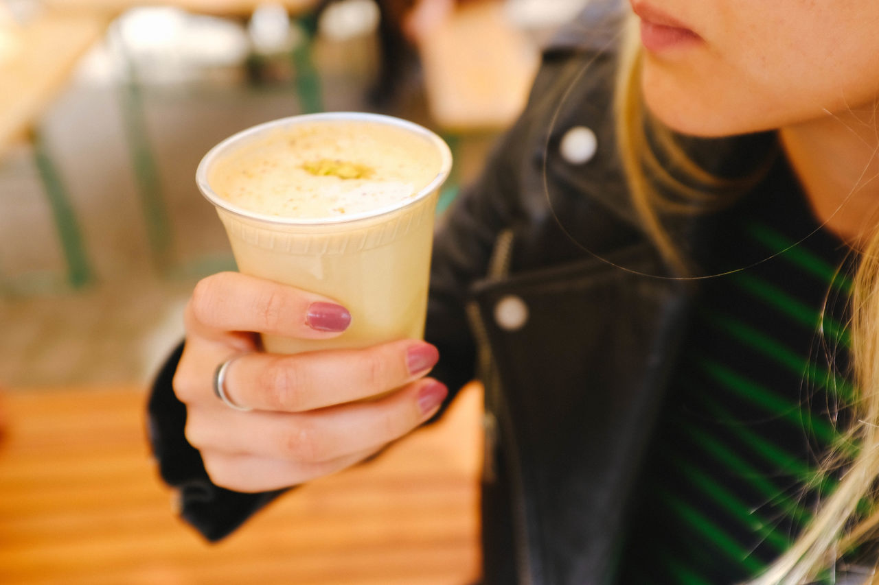 Cafe Cappuccino Close-up Coffee - Drink Coffee Cup Day Drink Focus On Foreground Food And Drink Freshness Froth Art Frothy Drink Holding Human Hand Indoors  Latte Lifestyles One Person People Real People Refreshment Table Women