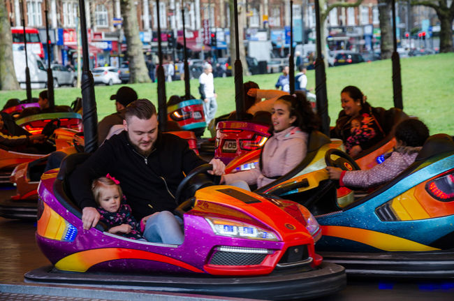 People having fun on the dodgems at the funfair. Cars Colour Dodgems Enjoyment Excited Excitement Exciting Fair Fun Fun Leisure Activity Louvre