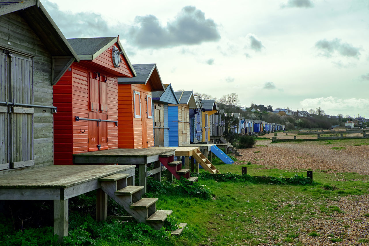 Waiting for a better season - Architecture Beach Beach Hut Building Exterior Built Structure Cloud - Sky Grass Green Color Hut Multi Colored Nature Outdoors Playground Sky Wood - Material
