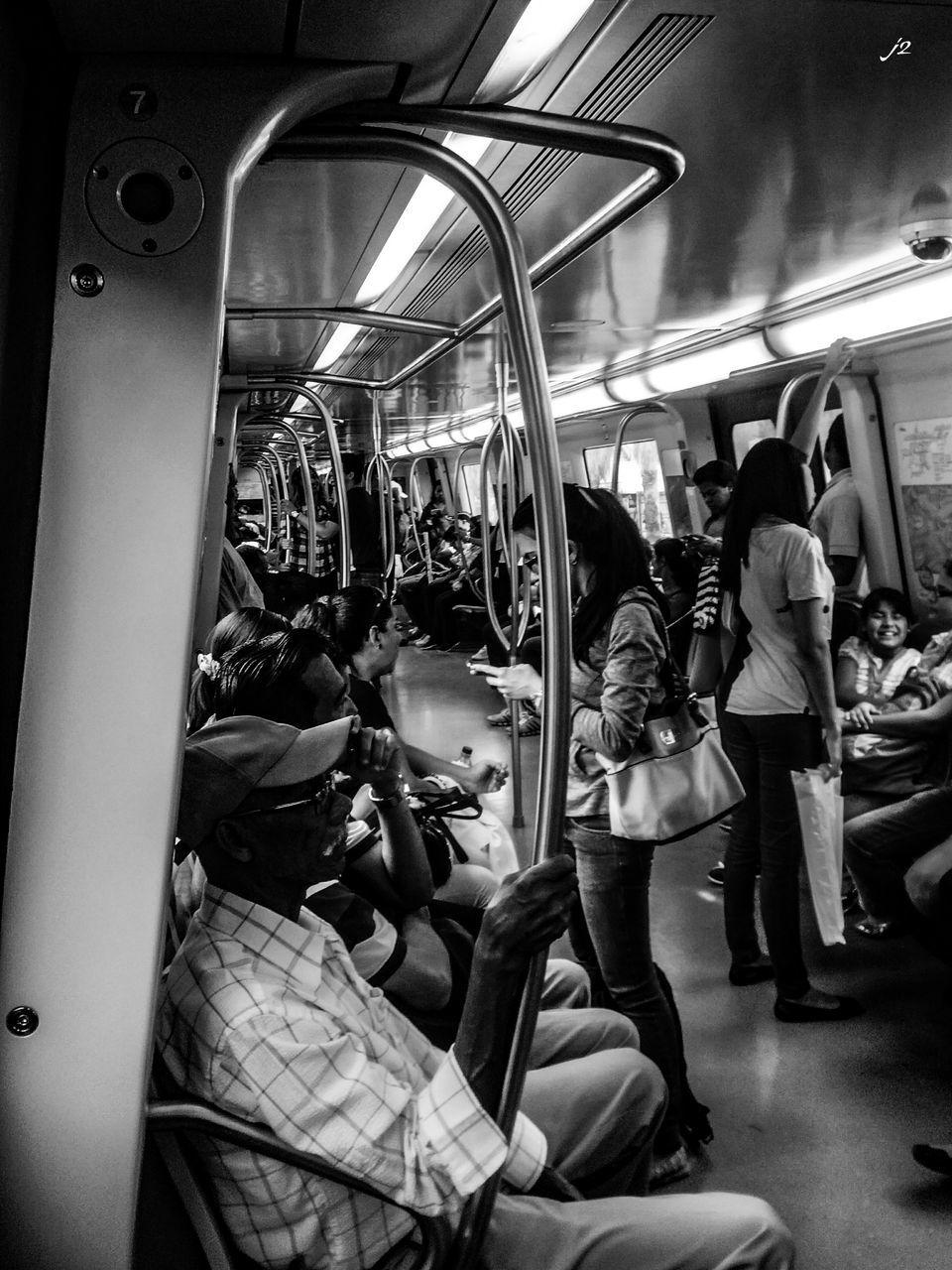 public transportation, large group of people, real people, subway train, women, transportation, men, lifestyles, illuminated, indoors, sitting, vehicle seat, commuter, night, commuter train, adult, people