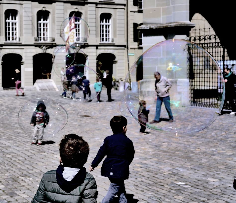 Break The Mold From My Point Of View EyeEm Gallery Soapbubbles Rainbow Colors Berner Münster Travel Destinations City Childhood Soap Bubbles Reflection Reflections Child Ladyphotographerofthemonth Tourism Ispiration