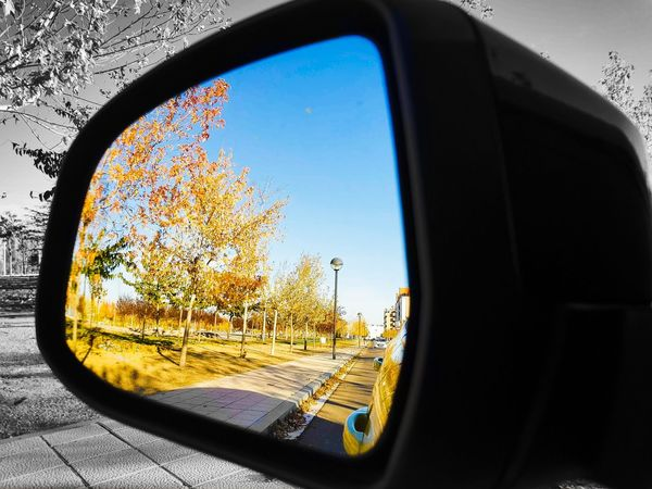 leave the bad behind Valladolid España Retrovisor Rearview Car Side-view Mirror Mirror Vehicle Mirror Window Transportation Reflection Sunset Point Of View Mode Of Transport No People Tree Road Day Outdoors Sky Close-up