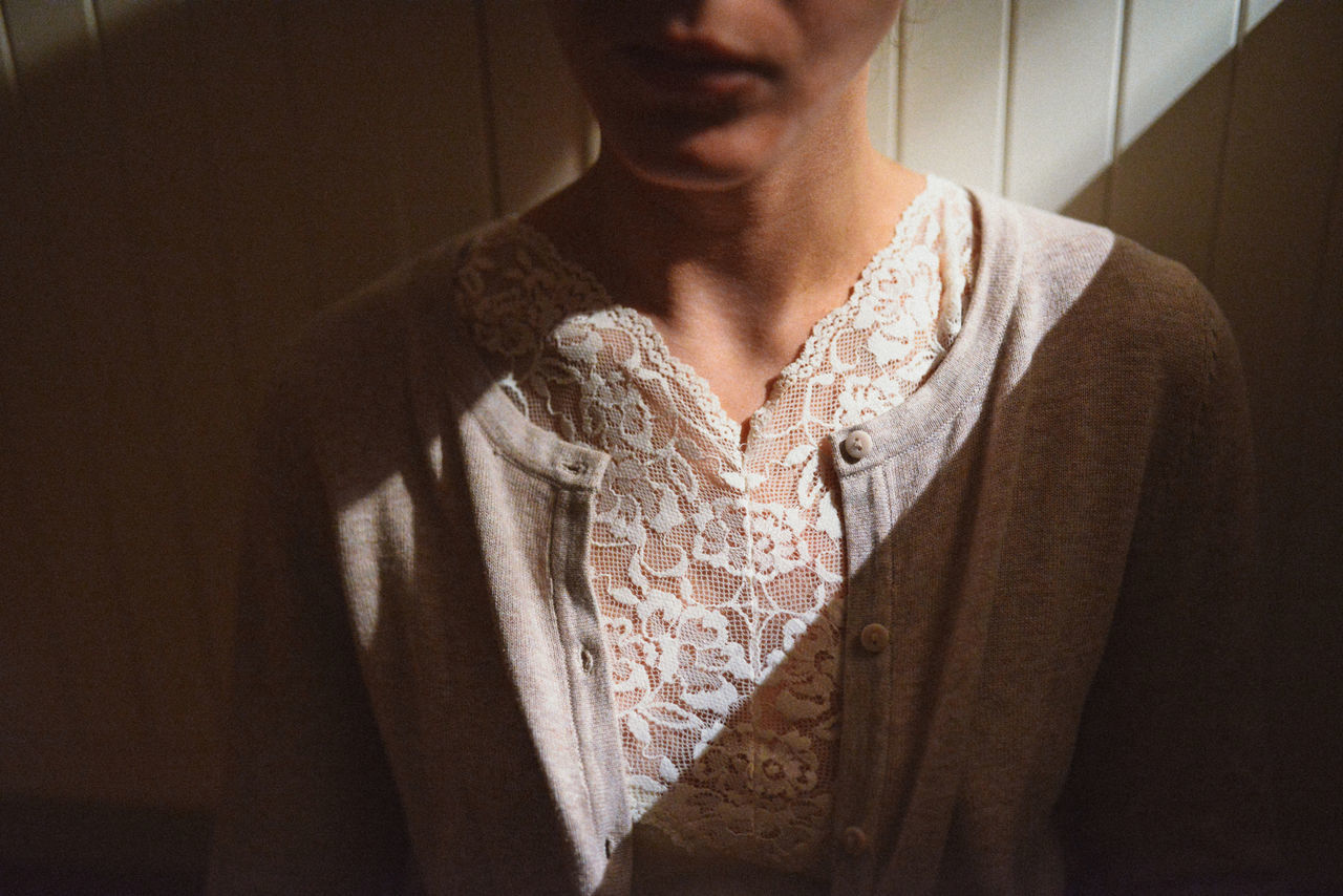 Close-up Fashion Front View Indoors  Intimacy Lace Lifestyles Lips Midsection Neck One Person One Woman Only Real People Retro Light And Shadow Portrait Of A Woman Indoors  Sweter Lifestyle Human Body Part Calm Shadows & Lights Loneliness Soft Colors  Uniqueness Lieblingsteil