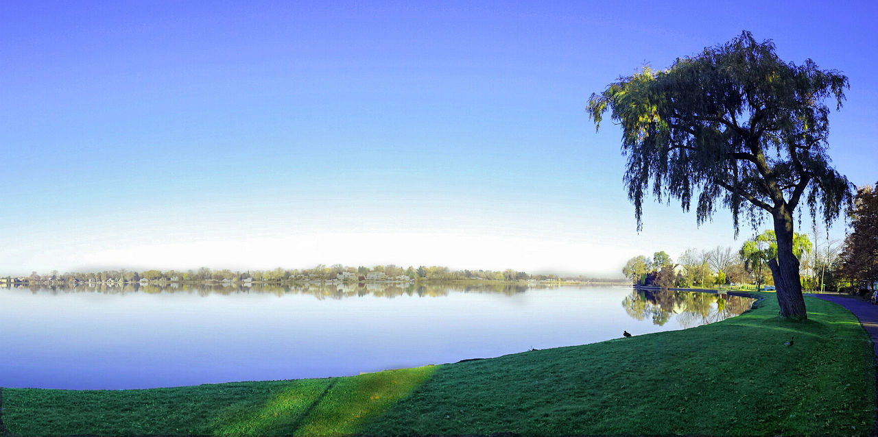 Calm Distant Lake Lakefront Lakeshore Majestic Morning Outdoors Reflection Remote Rippled River Riverbank Scenics Standing Water Sunrise_Collection Sylvan Lake Tranquil Scene Tranquility Tree Tropical Climate Water Waterfront