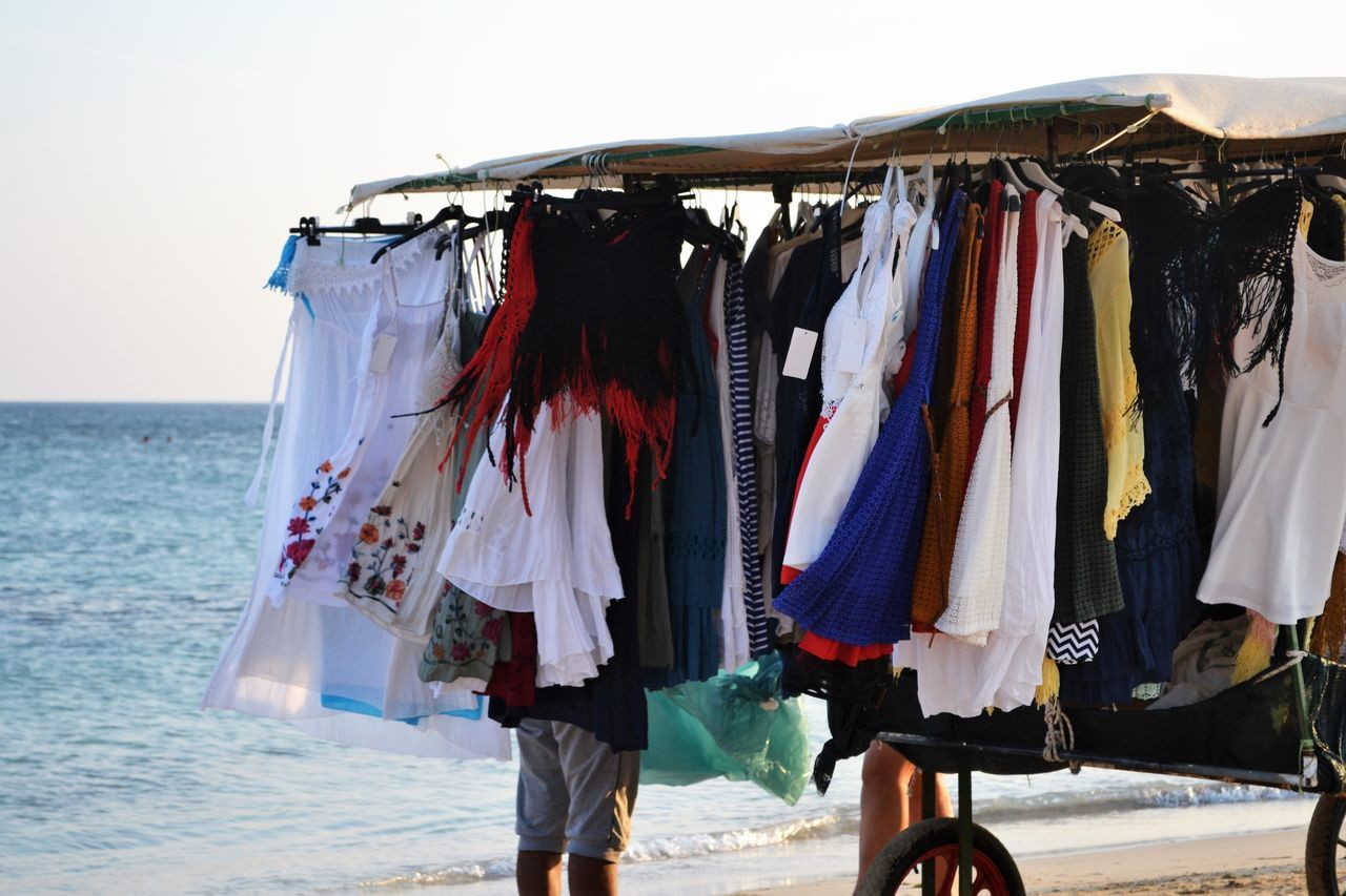 Clothes Rack Clothing Collection Colors Day Hanging Italy Large Group Of Objects Laundry Lifestyle Long Hair Outdoors Person Puglia Salento Puglia Sea Shopping Time Summer Summertime Textile Vacations Variation Venditoriambulanti Vestiti Water