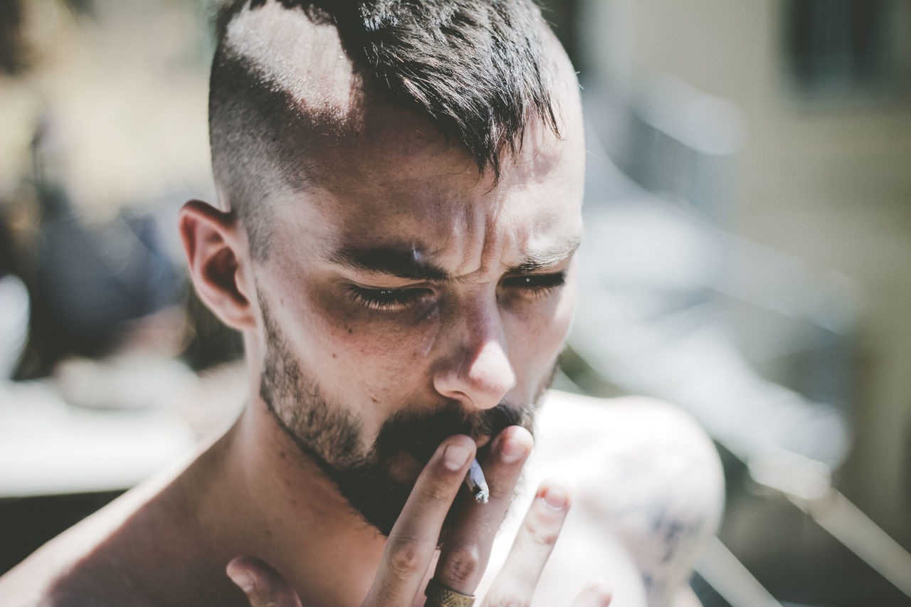 Close-Up Of Man Smoking Cigarette