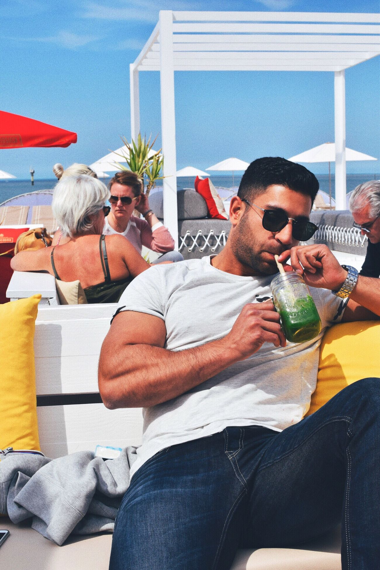Live For The Story beach drinks Sunglasses Men Sitting Vacations Day Outdoors Adult Adults Only People Young Adult