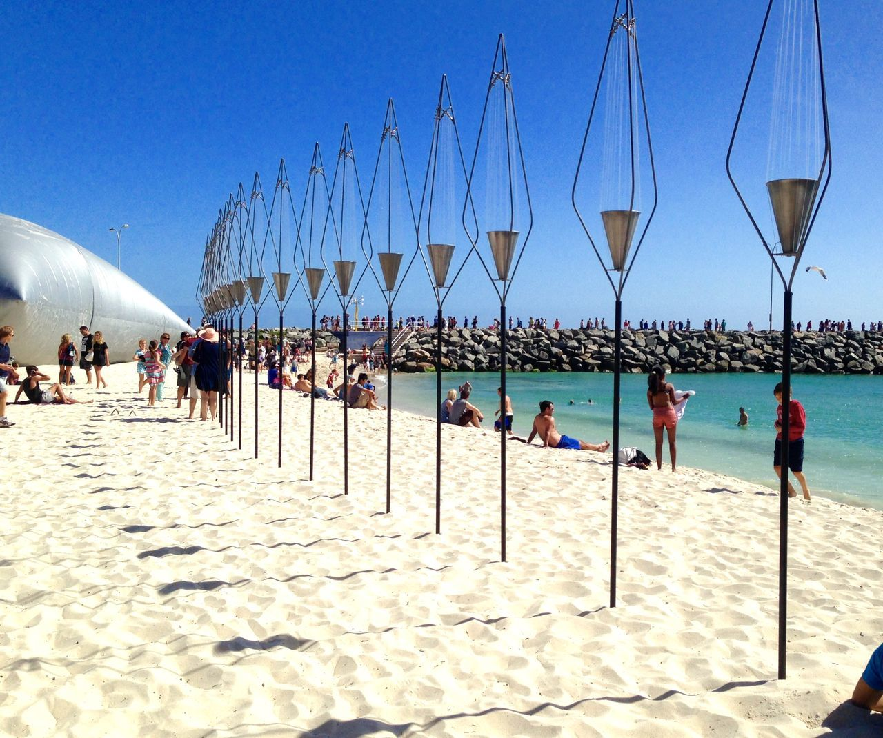 Sculpture by the Sea: Cottesloe Beach-circa March 2014-Metal Art in a Row Western Australia Weekend Activities Vacations Sculptures By The Sea Sculpture Recreational Pursuit Pole Perth Outdoors Ocean Incidental People Expressive Sculpture Enjoyment Cottesloe Beach Connection Interactive  Built Structure Beach Art Event Art Abstract Poles On Beach Row Of Poles Metal Sculpture Metal Art