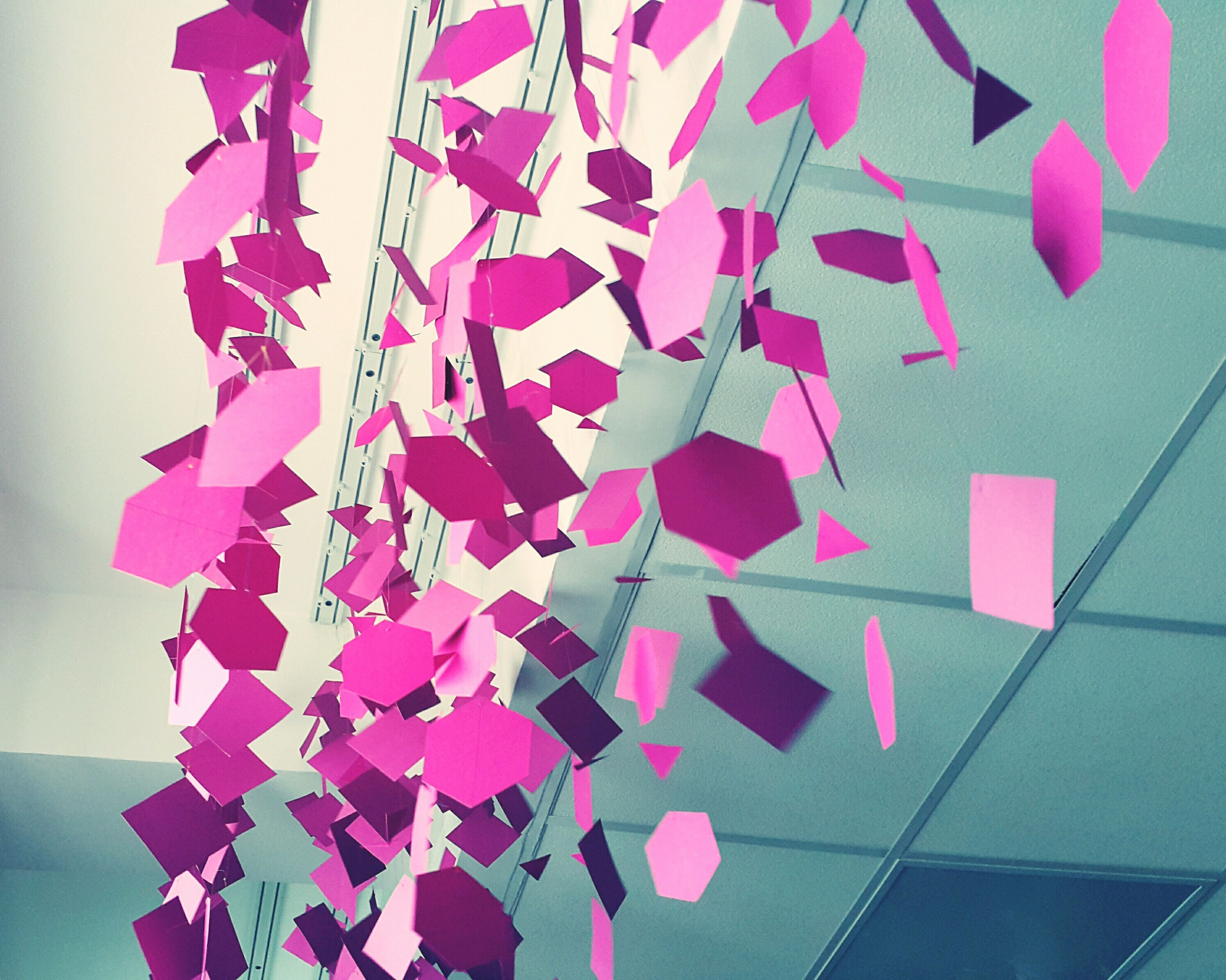 indoors, hanging, decoration, multi colored, variation, art and craft, still life, low angle view, paper, wall - building feature, celebration, creativity, no people, close-up, pattern, art, red, pink color, in a row, colorful