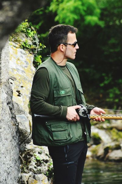 People Mid Adult One Person Casual Clothing Sunglasses Real People Leisure Activity Outdoors Day Lifestyles Standing Focus On Foreground Young Adult Nature Weapon Pesca Salmon River Trail