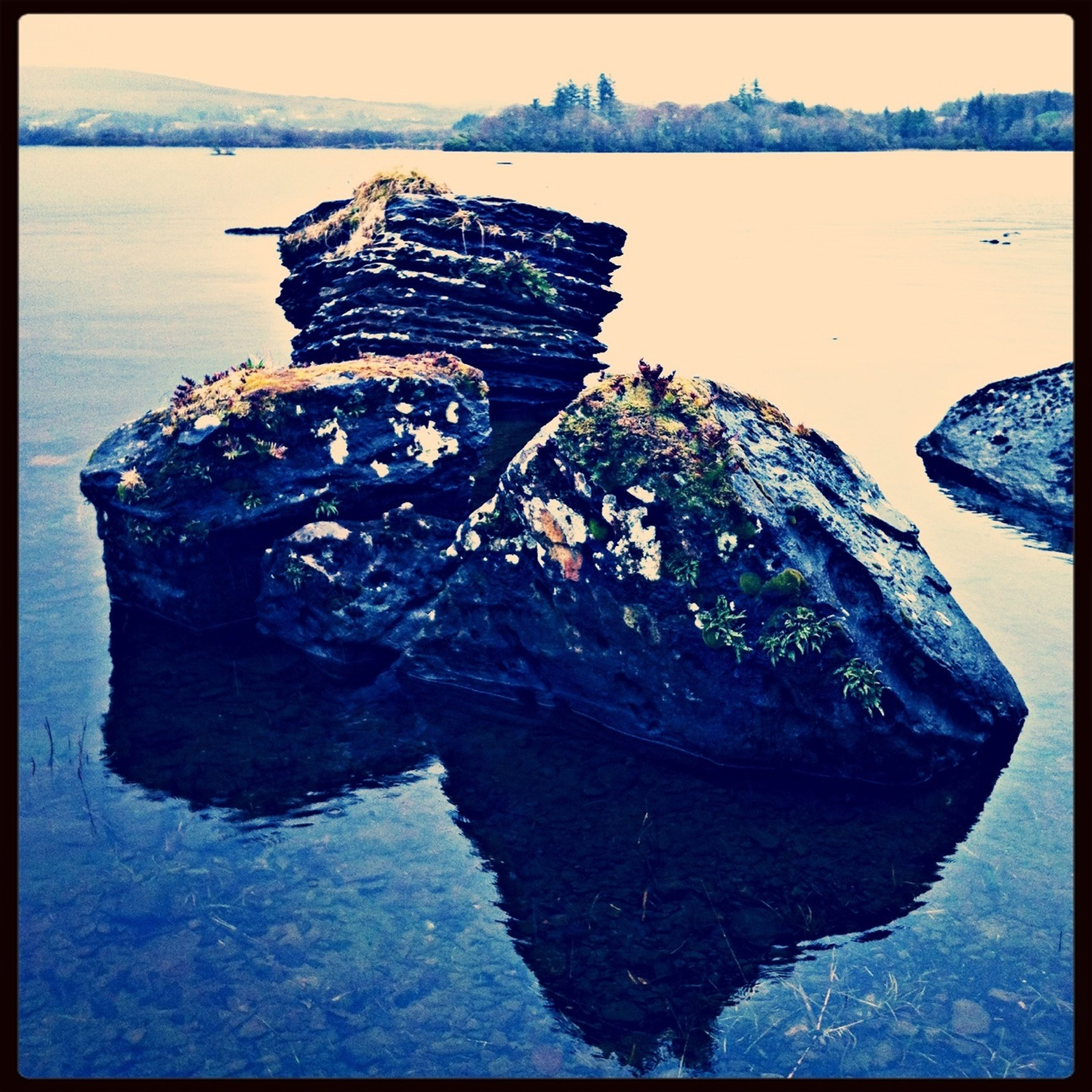water, transfer print, auto post production filter, sea, tranquility, tranquil scene, rock - object, lake, nature, high angle view, scenics, reflection, waterfront, beauty in nature, outdoors, day, shore, beach, river, no people