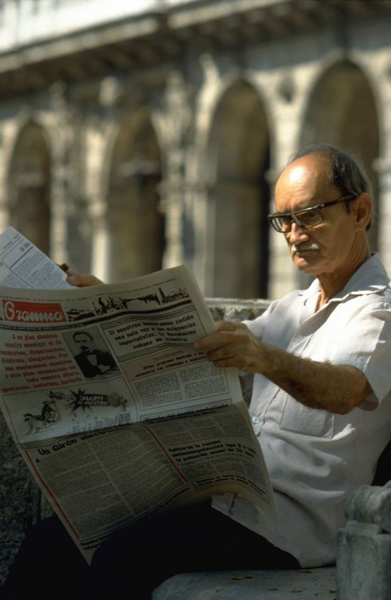 Old man reading the news in Havana, Cuba. http://pics.travelnotes.org Arches Candid Caribbean Colonial Architecture Cuba Cuban Daily Life Depth Of Field Focus Object Glasses Granma Havana Michel Guntern Newspaper Old Man Photojournalism Reading Reading The News Street Photography Snap a Stranger The Tourist Travel Travel Photography Travel Photos Travel Pics Neighborhood Map