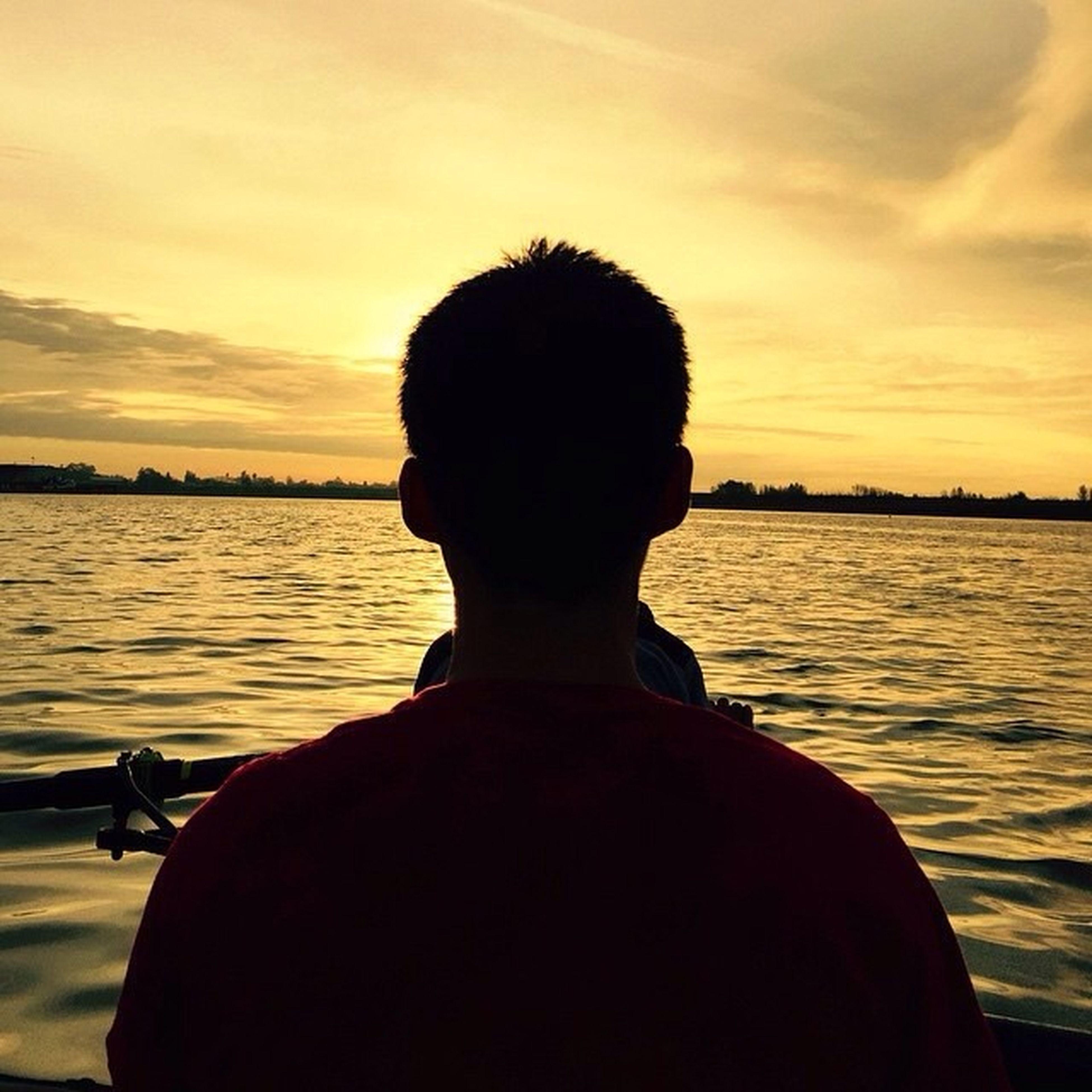 sunset, water, sky, silhouette, rear view, cloud - sky, lifestyles, men, leisure activity, sea, orange color, standing, waist up, nautical vessel, scenics, cloud, dusk, sitting