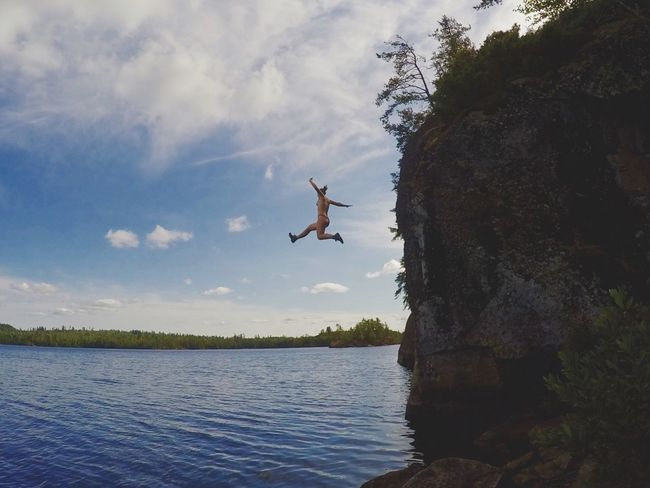 Action Shot  Beauty In Nature CliffJumping Cloud Cloud - Sky Day Idyllic Jump Jumping Nature No People Non Urban Scene Non-urban Scene Outdoors Rippled Scenics Sky Spread Wings Tranquil Scene Tranquility Tree Water