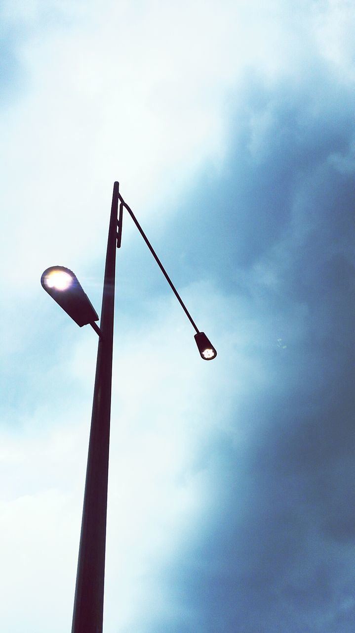 low angle view, sky, cloud - sky, lighting equipment, street light, no people, road sign, day, outdoors