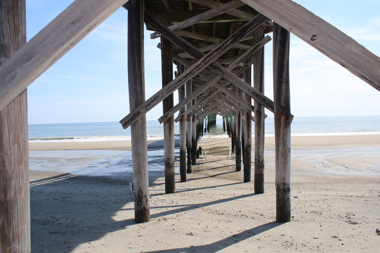 Fishing Pier Architecture Beach Beauty In Nature Below Built Structure Day Horizon Over Water Idyllic Nature No People Outdoors Pier Sand Scenics Sea Sky Summer Tranquil Scene Underneath Vacations Water Wood - Material