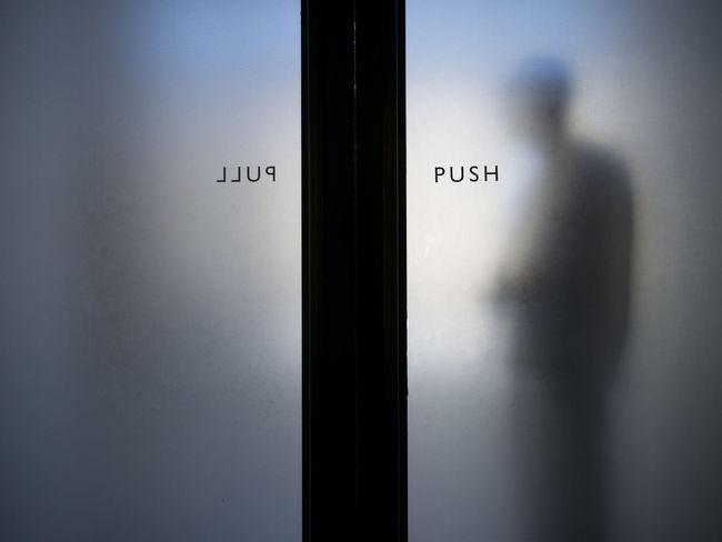 Silhouette of a man behind opaque glass doors. Close-up Day Door Doorway Glass Door Indoors  Pull Push Silhoutte Sliding Door Text