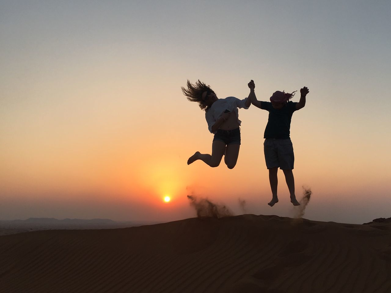 Adh Dhayd 🇪🇭 Sunset Two People Full Length Mid-air Jumping Young Adult Leisure Activity Real People Lifestyles Motion Women Men Outdoors Silhouette Landscape Young Women Nature Adult Adults Only Sky Dubai Likesforlikes Likeforlike Photography