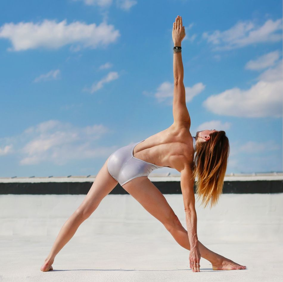 Beautiful stock photos of yoga, 45-49 Years, Arms Outstretched, Beach, Bending