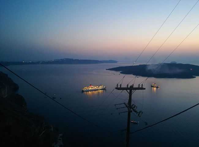 🇬🇷 Greece View From Above Bird's Eye View Ship Holiday POV Water Sea Nautical Vessel Sunset Santorini Dusk Scenics Tranquility Mode Of Transport Tranquil Scene Cable Harbor Ship Nature Sky Beauty In Nature Non-urban Scene Journey Blue Steel Cable