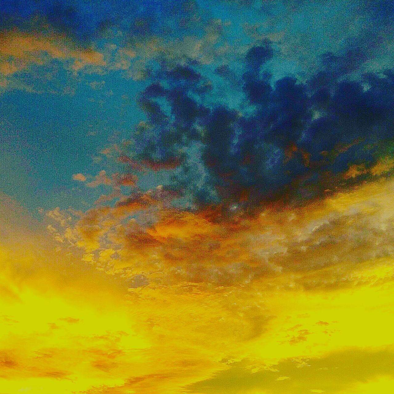 sky, cloud - sky, dramatic sky, sunset, abstract, orange color, low angle view, beauty in nature, backgrounds, nature, sky only, yellow, no people, full frame, outdoors, scenics, multi colored, tranquility, blue, day
